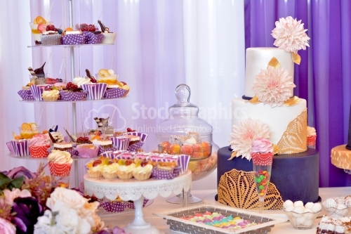 Candy bar. Table with sweets, candies, dessert. Cake with big beige chrysanthemums.