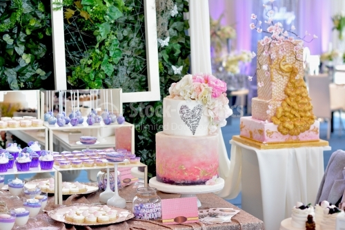 Candy bar. White-pink cake, with pink flowers, gold foil and messages of love