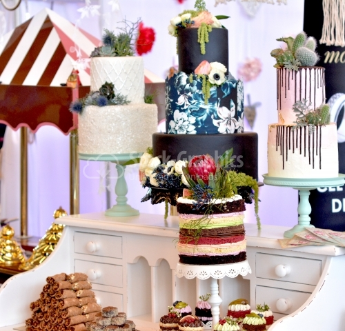 Candy bar with a multitude of cakes on different themes