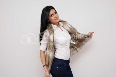 Caucasian model in beige fur vest