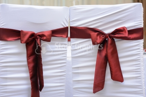 Chair for groom and bride with red accents