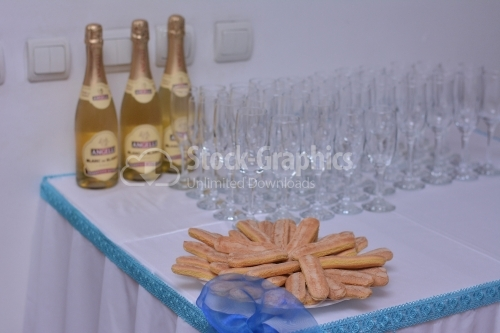 Champagne, glasses and cookie on the table