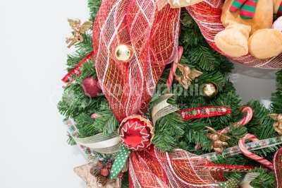 Christmas bauble on artificial christmas wreath