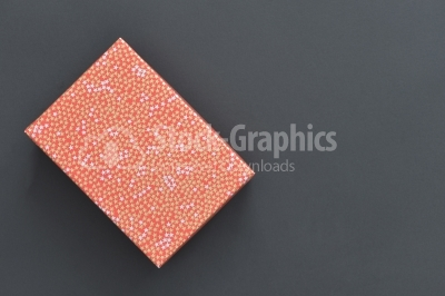 Christmas holiday gift box in spotted paper isolated