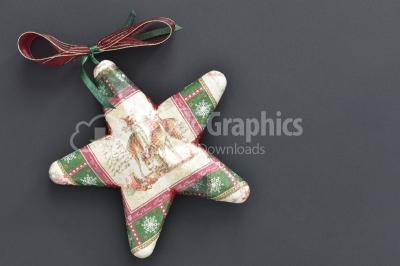 Christmas star on dark wooden background