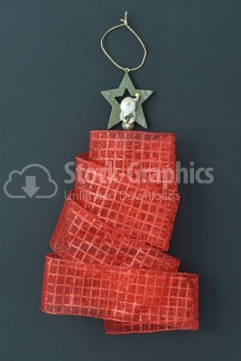 Christmas tree made of a red ribbon