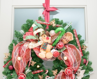 Christmas wreath with red ribbon and small ornaments