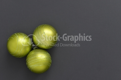 Christmas yellow balls on a dark background