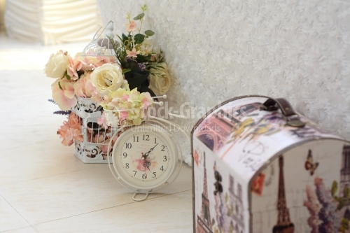 Clock chest and flower arrangements