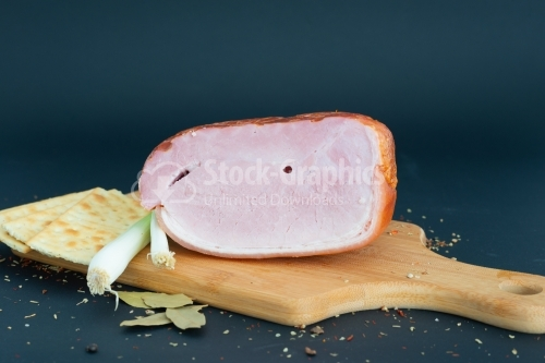 Close up Prague baked ham isolated on cutting board