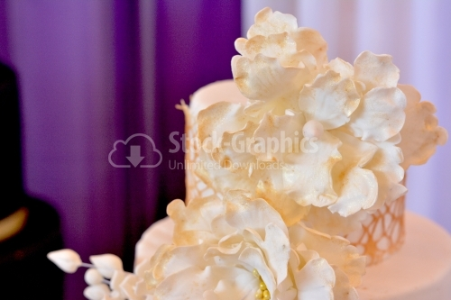Close-up of beige marzipan flowers with gold glitter