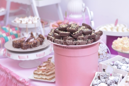 Cocoa cakes in a pink decor. Dessert table for a party.