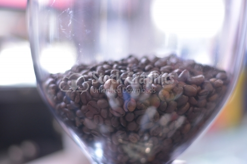 Coffee beans in a dirty glass