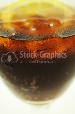Cola with ice and lemon in a glass - Stock Image