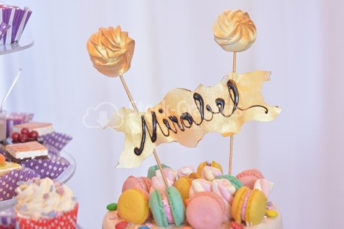 "Colorful macarons cake with the name ""Mirabel"". Top view"