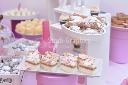 Cookies with walnut and white cream, and vanilla cream croissants. Candy bar.