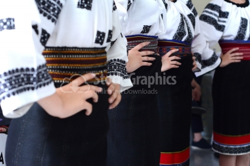 Couple of girls dancing in traditional clothes
