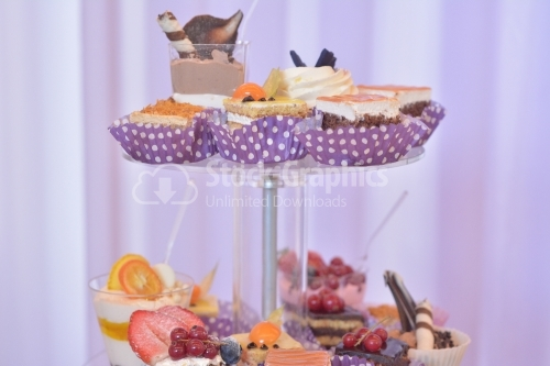 Cream layers cakes and assorted fruits. Candy bar