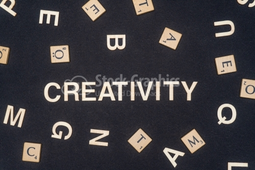 CREATIVITY word written on dark paper background. CREATIVITY text for your concepts
