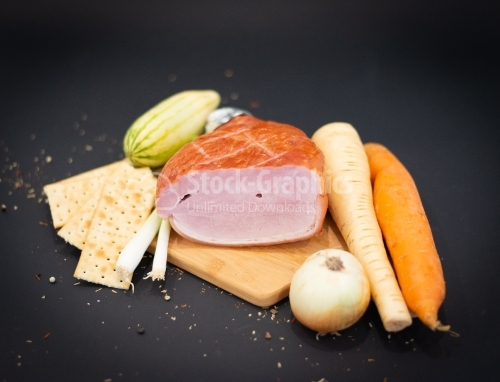 Cutting board with lots of vegetables and Smoked ham