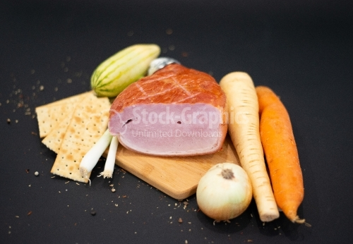 Cutting board with lots of vegetables and Smoked Prague Ham