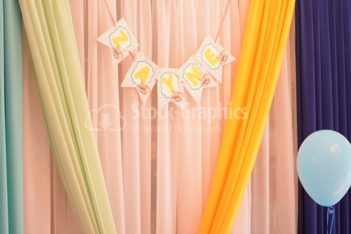Decorative drapery tulle with a baby name on it