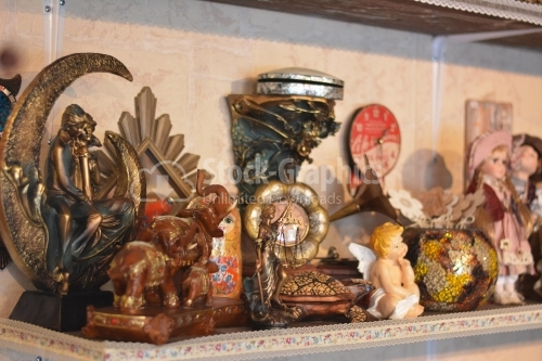 Decorative objects on a store shelf.