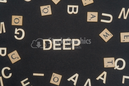 DEEP word written on dark paper background. DEEP text for your concepts