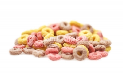 Delicious and nutritious fruit cereal loops flavorful on white background