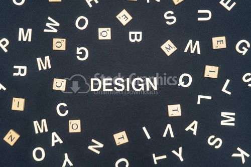 DESIGN word written on dark paper background. DESIGN text for your concepts
