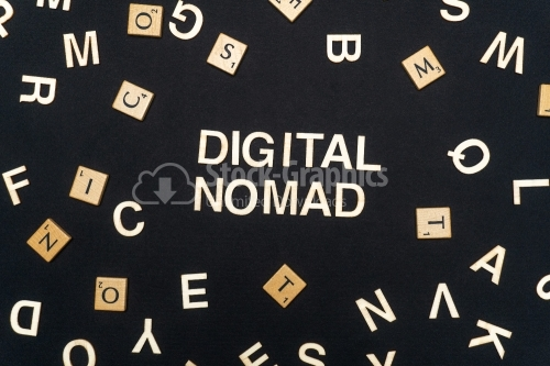 DIGITAL NOMAD word written on dark paper background. DIGITAL NOMAD text for your concepts