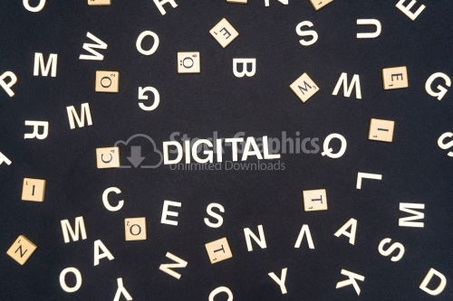 DIGITAL word written on dark paper background. DIGITAL text for your concepts