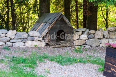 Dog house surrounded by stone fence