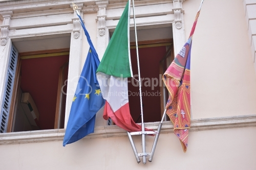 European flag and italian flag on window