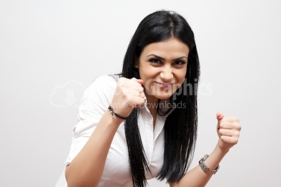 Excited happy woman with fists up