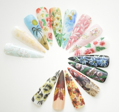 Fake nails painted with floral motifs