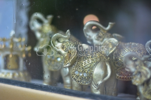 Feng shui elephants in a showcase.