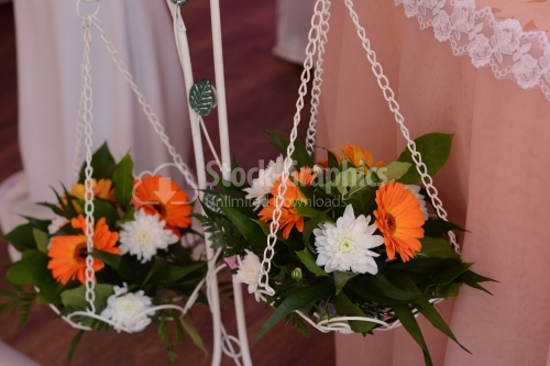 Flower arrangements hanging on a vase