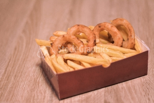 French fries and onion rounds in a cardboard box