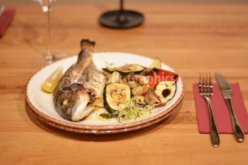 Fried trout with sauteed mushrooms and grilled peppers and zucchini.