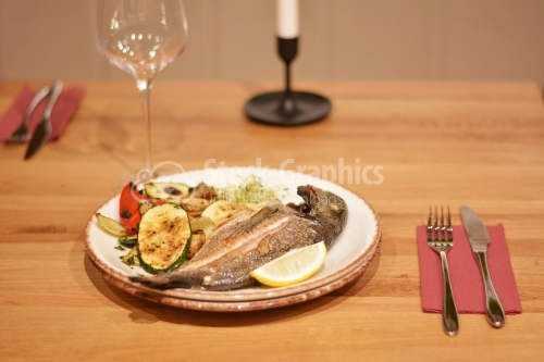 Fried trout with sauteed mushrooms and grilled vegetables.