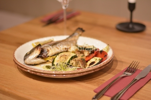 Fried trout with vegetables and wheat germ.