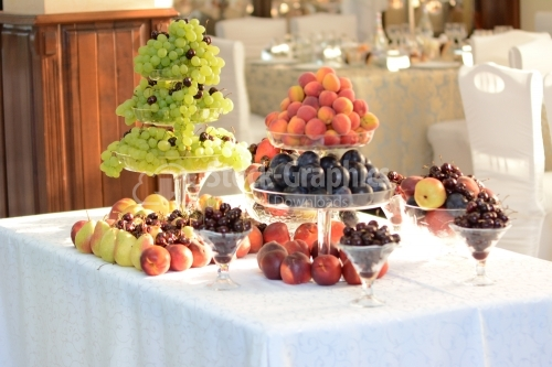 Fruit bowl with grapes, apricots, nectarines, plums, pears, cherries