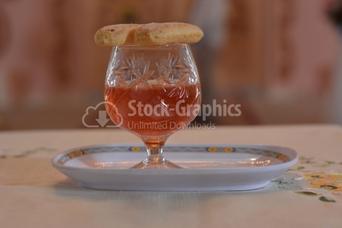 Glass of wine with snack on top