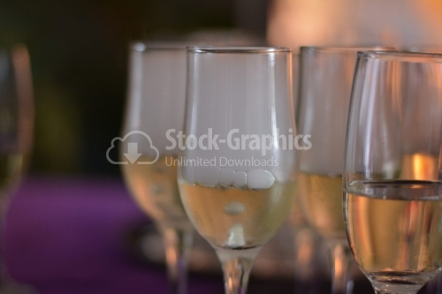 Glasses with cold champagne and carbonated ice