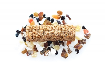 Granola bar with dried fruits on white background