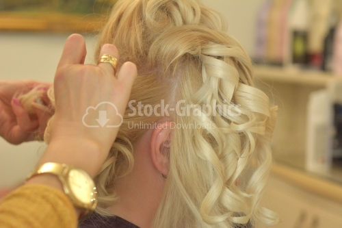 Hairdresser working on a blonde woman
