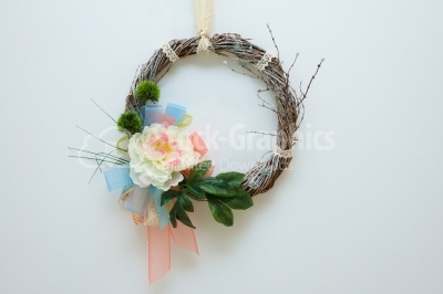 Hand made spring wreath on white background