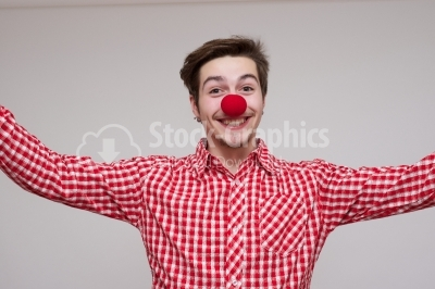Happy young with red nose