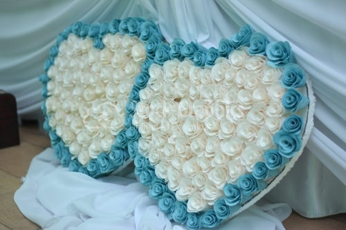Heart made of flowers on a blue background